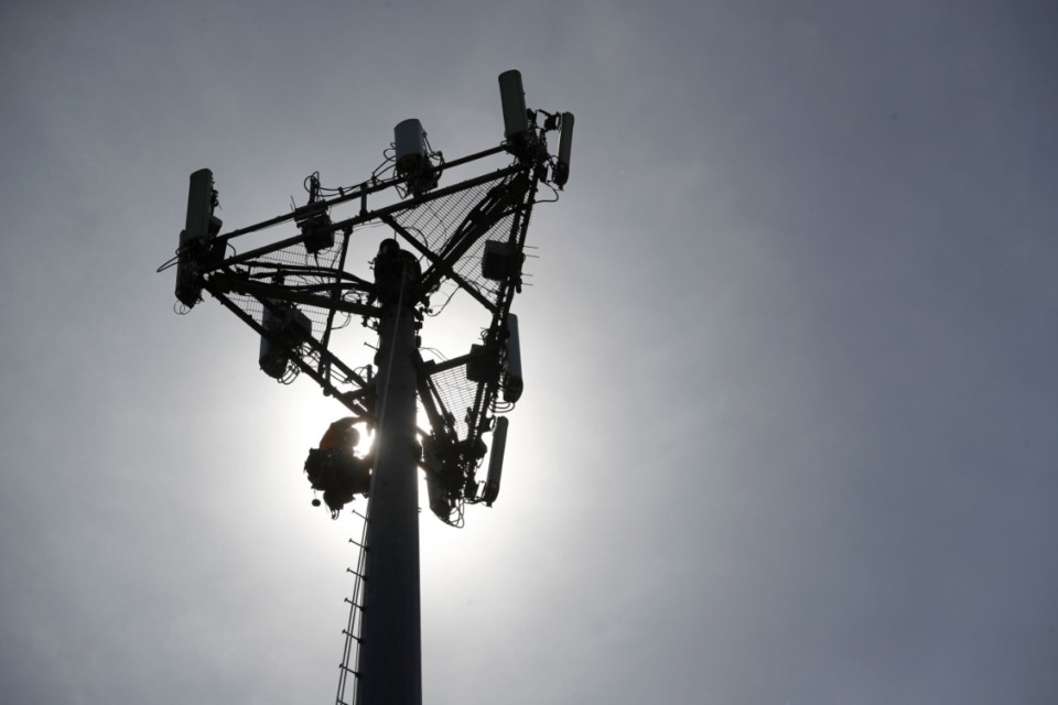 <span><strong>A worker climbs down from a cellular phone town on Monday, May 22, 2017, in High Ridge, Mo. A similar cell tower will be placed at Dogwood Elementary School.</strong>&nbsp;(Jeff Roberson/AP file)</span>