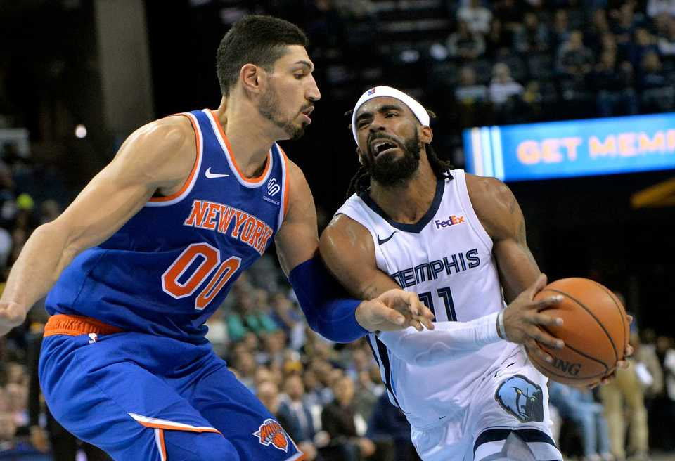 <span><strong>Memphis Grizzlies guard Mike Conley (11) drives against New York Knicks center Enes Kanter (00) in the second half of an NBA basketball game Sunday, Nov. 25, 2018, in Memphis, Tenn.</strong> (AP Photo/Brandon Dill)</span>