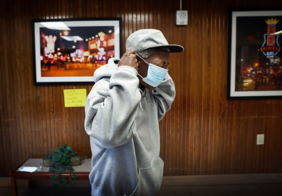 <strong>Memphis Housing Authority resident Roscoe Wells puts on a donated face mask on Thursday, April 23, 2020 at Dr. R.Q. Venson Center Apartments.&nbsp;</strong>(Mark Weber/Daily Memphian)