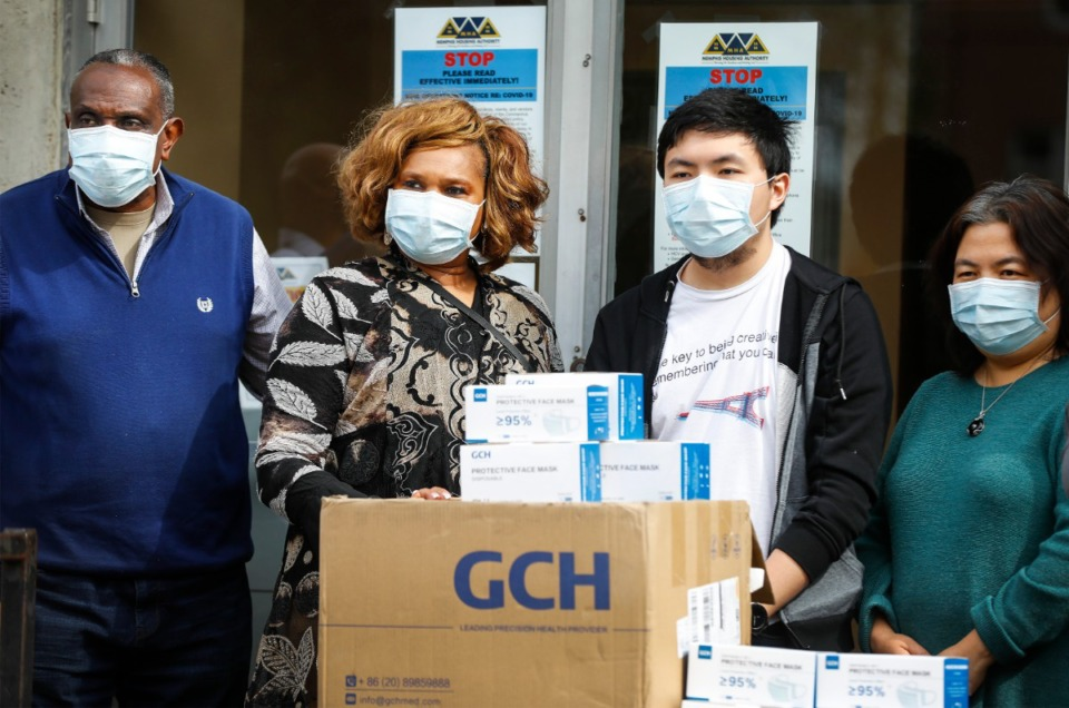 <strong>Business partners Ronald and Carolyn Kent, (left) and King and Jasmine Chow donated 10,000 protective masks on Wednesday, April 22, 2020. The two families are co-owners of the Chow Time and China Inn restaurants.</strong>(Mark Weber/Daily Memphian)