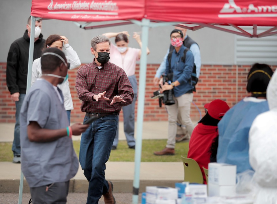 <strong>Tennessee Governor Bill Lee thanks Memphians sitting in line to be tested for COVID-19 by National Guard Medics during a visit to the Christ Community testing site in Frayser on April 25, 2020.</strong> (Jim Weber/Daily Memphian)