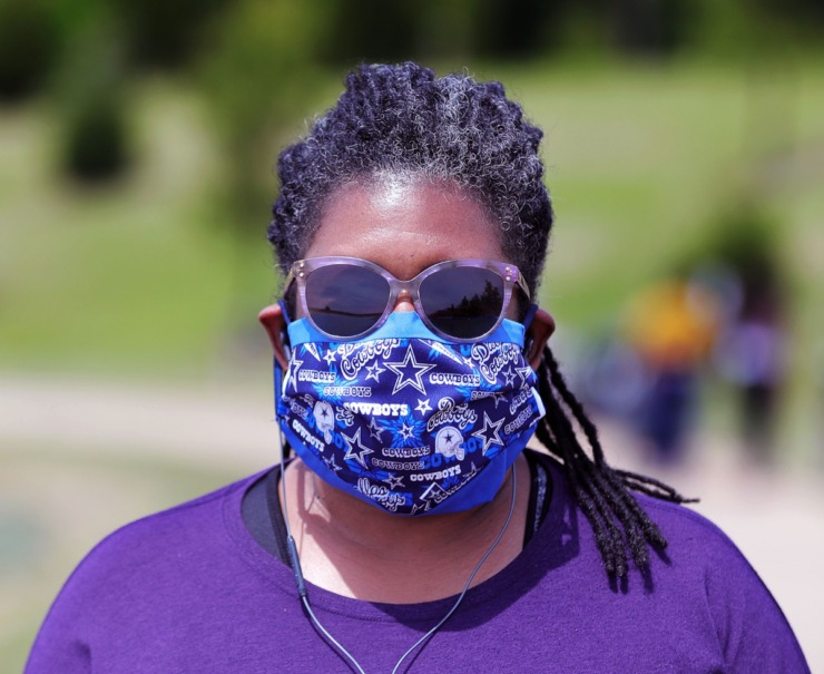 <strong>Taking the recommended safety measure of wearing a mask when going out in public, Jacqui Anderson walks around Hyde Lake in Shelby Farms Park on May 1, 2020.</strong> (Patrick Lantrip/Daily Memphian)