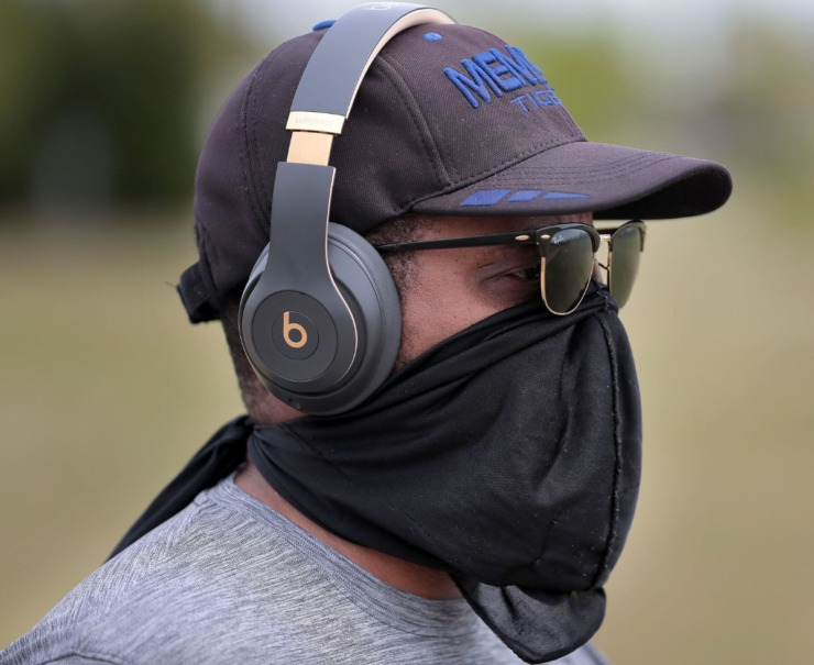 <strong>William Reynolds of Bartlett protects himself while walking at Shelby Farms as Memphians practice social distancing during workouts, dog walks and bike rides either alone or in small groups on April 4, 2020.</strong> (Jim Weber/Daily Memphian)