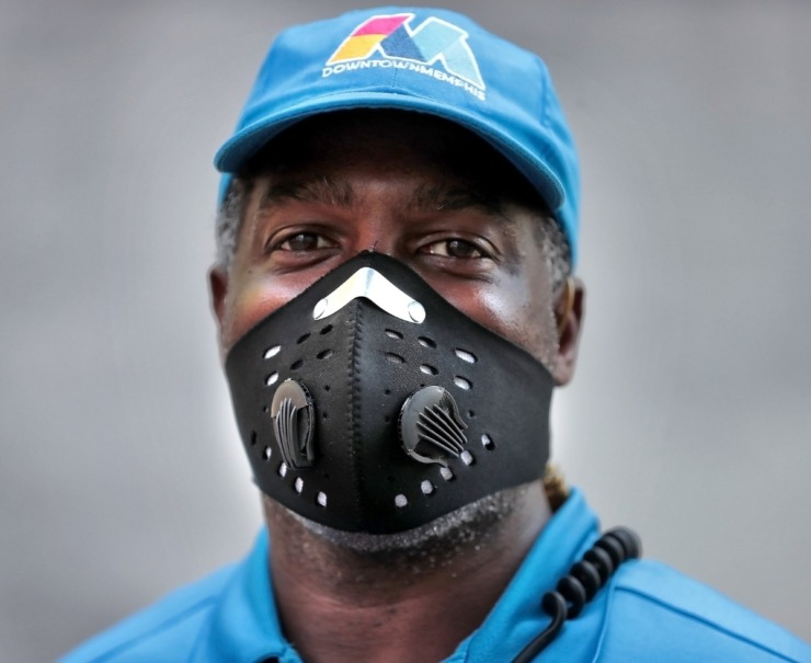 <strong>Blue Suede Brigade member Marcus Daniels goes with a neoprene mask complete with purge valves while walking his route along Main Street in Downtown Memphis on May 1, 2020.</strong> (Jim Weber/Daily Memphian)