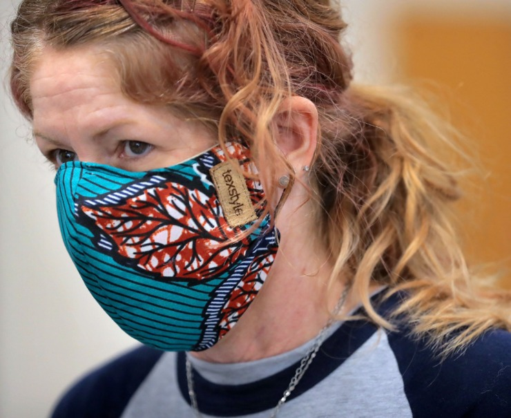 <strong>Terri Harris, Director of Marketing and Communications, wears a mask made by a local artist as she volunteers during a food drive at the University of Memphis International Center on May 2, 2020.&nbsp;Many of the school&rsquo;s international student population have been unable to return home while remotely finishing coursework for the semester.&nbsp;</strong>(Jim Weber/Daily Memphian)