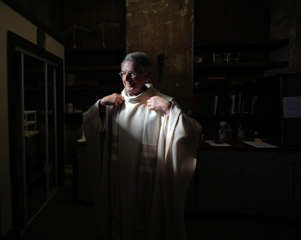 <strong>Monsignor Val Handwerker gets ready before a virtual mass at St. Patrick Catholic Church May 3, 2020.</strong> (Patrick Lantrip/Daily Memphian)