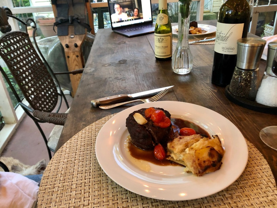 <strong>A filet with tomato confit, rosemary bordelaise and blue cheese Dauphinoise potatoes was the main course. Sisco Larson with Joe's is on Zoom in the background.</strong> (Jennifer Biggs/Daily Memphian)
