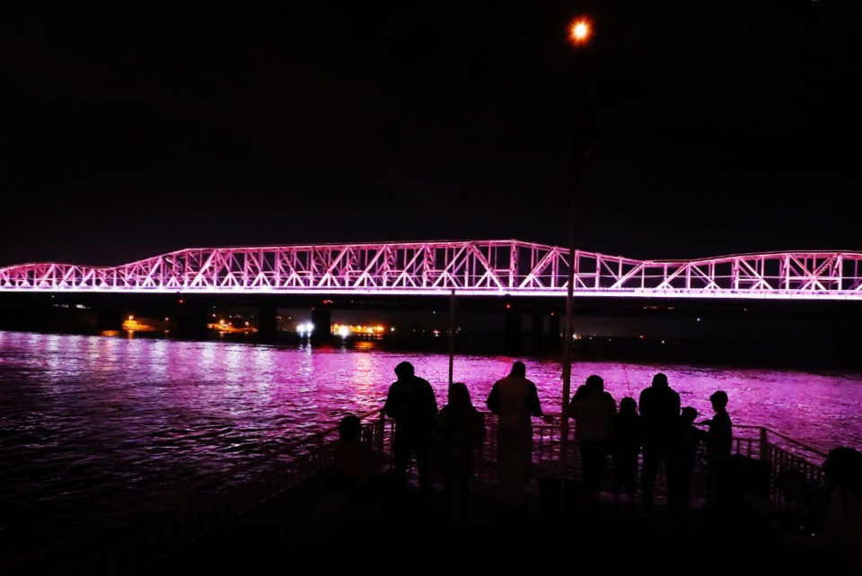 <strong>Folks gather on the deck to view the Mighty Lights bridge light show during a dinner cruise aboard the Memphis Queen III on March 29, 2019.</strong> (Jim Weber/Daily Memphian file)
