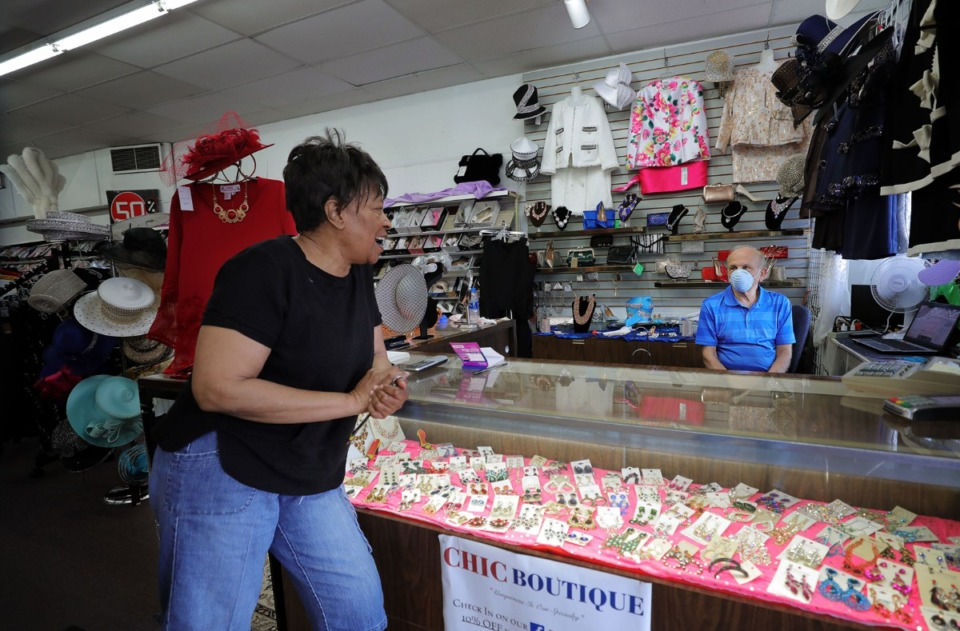 <strong>Dollie Massey jokes with her friend Mehdi Mostafavi, who owns the Chic Boutique clothing store in Whitehaven on Monday, May 4. Memphis and Shelby County began phase 1 of its Back to Business plan Monday, signaling the reopening of the local economy.</strong> (Patrick Lantrip/Daily Memphian)