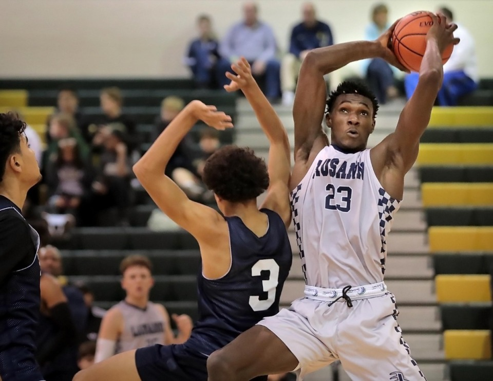 <strong>Lausanne forward Moussa Cisse draws a foul while going up for a shot against Briarcrest on Dec. 13, 2019, during their game at Briarcrest High School.</strong> (Jim Weber/Daily Memphian)