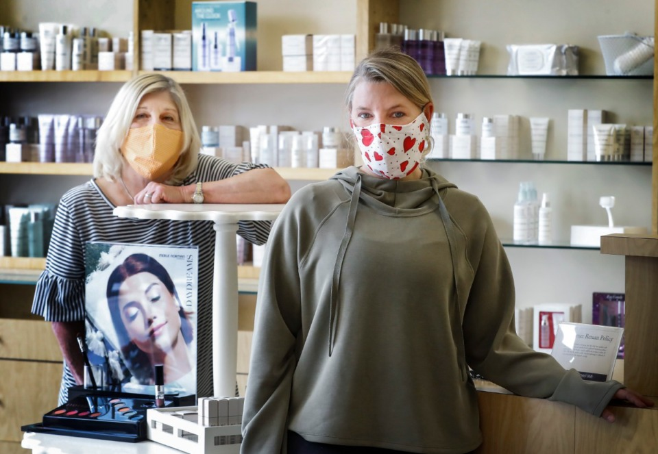 <strong>Merle Norman Cosmetics Owner Kelley Dennis (right) and store manager Angela Thompson (left) opened their doors to customers on Monday, May 4, 2020.</strong> (Mark Weber/Daily Memphian file)