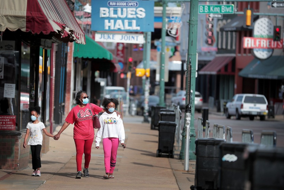 <strong>Jenny Rudd takes a walk down a newly reopened Beale Street with her granddaughters London Hayes (left) and Skyla Hayes on May 7, 2020. The City of Memphis announced Thursday afternoon that Beale Street businesses are allowed to open to customers beyond carry-out orders.</strong> (Jim Weber/Daily Memphian)