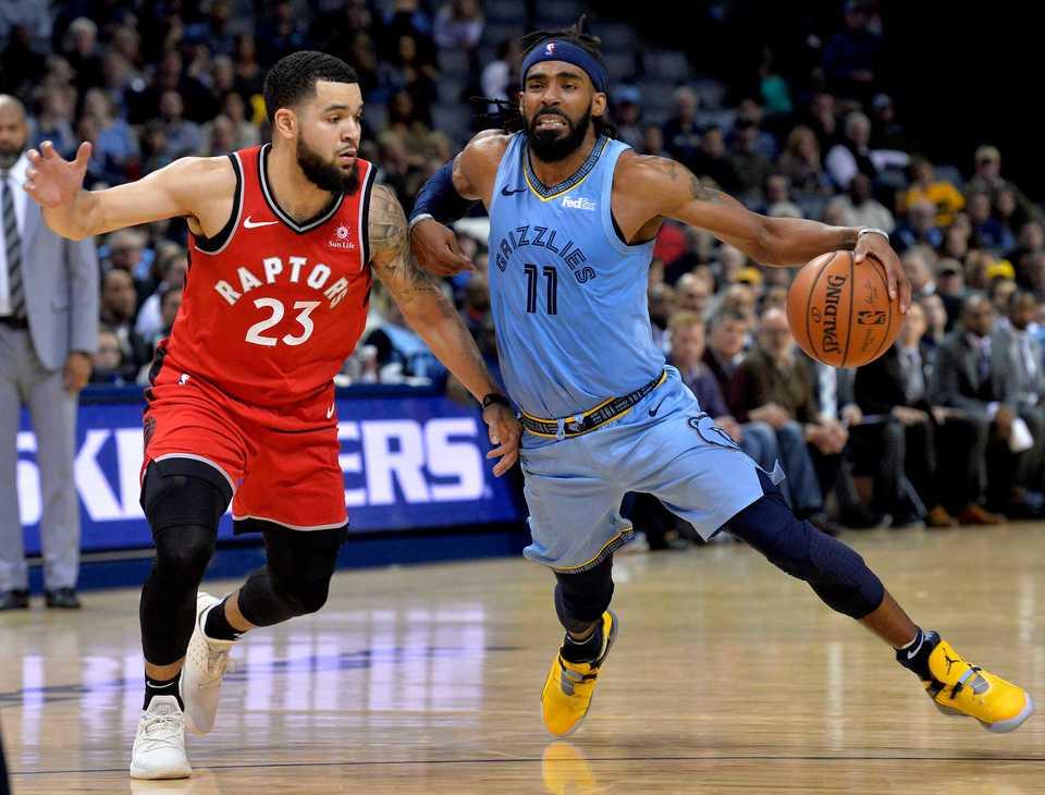 <strong>Memphis Grizzlies guard Mike Conley (11) drives against Toronto Raptors guard Fred VanVleet (23) in the second half of an NBA basketball game, Tuesday, Nov. 27, 2018, in Memphis, Tenn.</strong> (AP Photo/Brandon Dill)