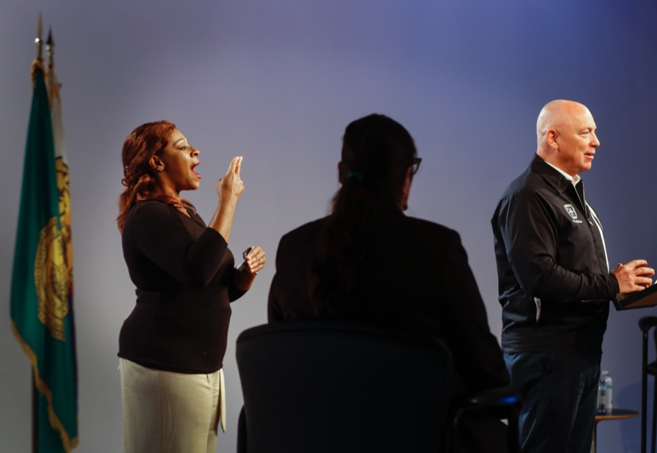 <strong>Sign language interpreter Brenda Cash (left) signs the words to the deaf and hard-of-hearing community as Memphis Chief Operating Officer Doug McGowen (right) speaks on Wednesday, May 6, 2020, during a COVID-19 task force briefing.</strong> (Mark Weber/Daily Memphian)