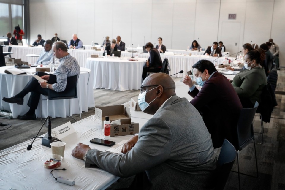 <strong>Reginald Milton (front) and his fellow Shelby County Commissioners practice social distancing while attending a Budget Reset Retreat on Friday, May 8, 2020, at Shelby Farms.</strong> (Mark Weber/Daily Memphian)