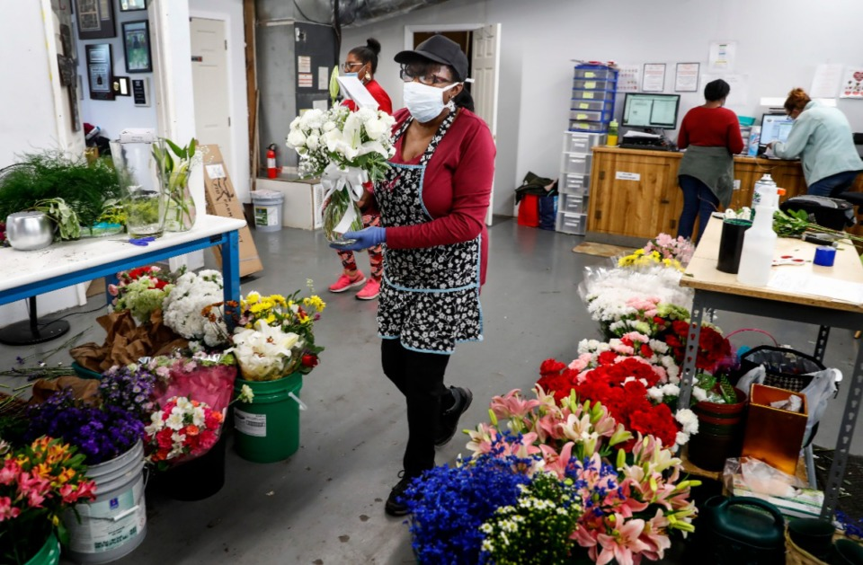 <strong>Flowers and More florist Ann Calicker (middle) prepares a Mother's Day arrangement on Wednesday, May 6, 2020.</strong> (Mark Weber/Daily Memphian)