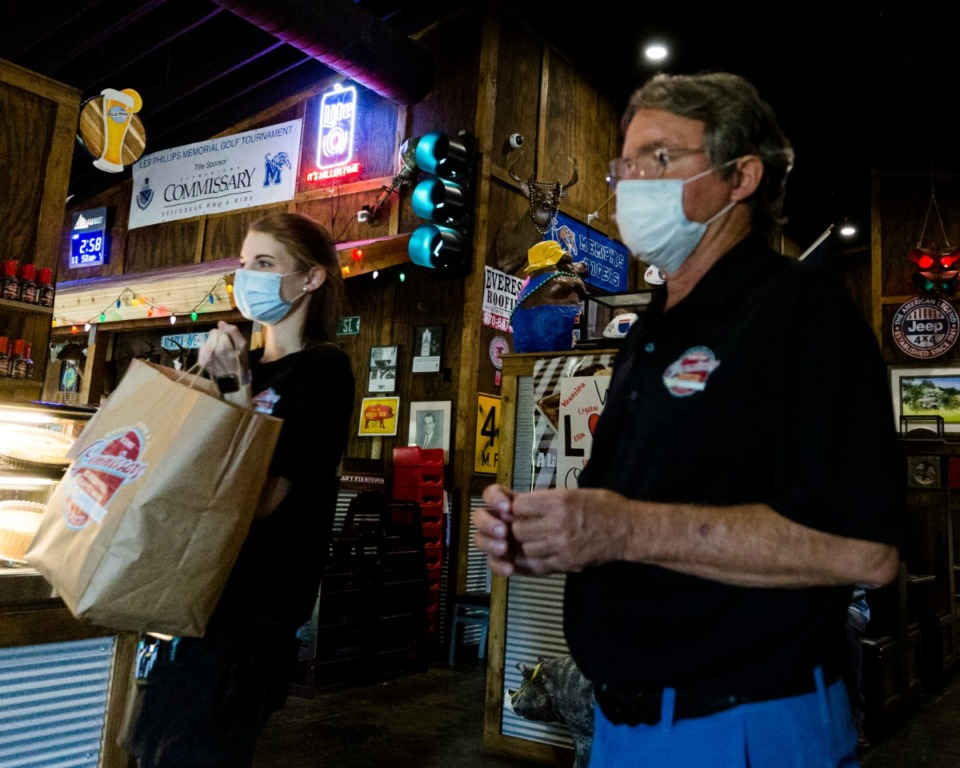 <strong>Commissionary BBQ owner Walker Taylor (right) and employee Haven Wilson deliver orders to carry-out customers at the restaurant's Collierville location on Sunday, May 10.</strong> (Ziggy Mack/Special to Daily Memphian)