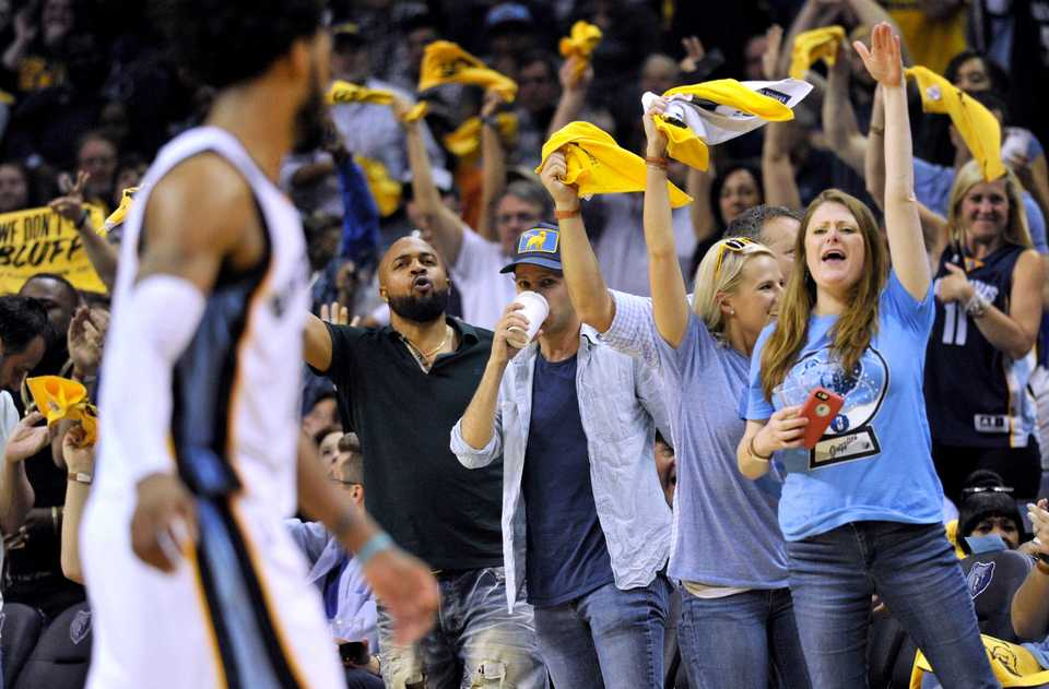 <strong>Fans cheer as Memphis Grizzlies guard Mike Conley, left, moves down the court during the second half of Game 6 of the team's NBA basketball first-round playoff series against the San Antonio Spurs, Thursday, April 27, 2017, in Memphis, Tenn.</strong> (AP Photo/Brandon Dill)