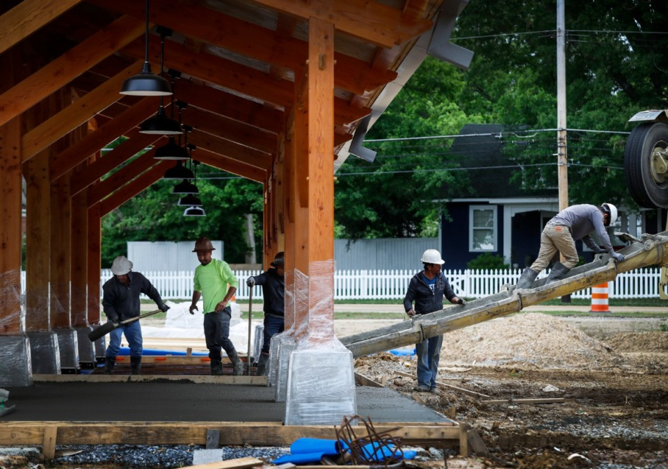 <strong>Construction continues at the new Arlington Municipal Complex on May 5 as workers lay concrete in a pavilion.&nbsp;The project is part of the $6 million Forrest Street Park master plan.</strong> (Mark Weber/Daily Memphian)