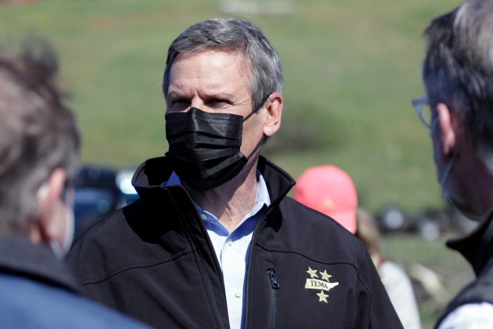 <strong>Tennessee Gov. Bill Lee, center, seen here with a mask on April 14, 2020, in Chattanooga. Lee doesn't believe fear of catching COVID-19 qualifies as a reason to vote by mail.</strong> (Mark Humphrey/AP)
