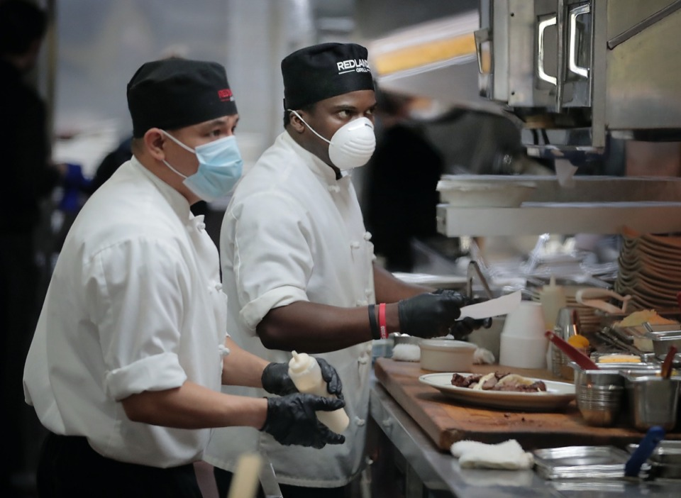 """<strong>Following implemmentation of Shelby County's """"Back to Business"""" plan, staff at J. Alexander's Redlands Grill in Cordova get things going again while trying to keep up with restrictions put in place because of COVID-19.</strong> (Jim Weber/Daily Memphian)"""