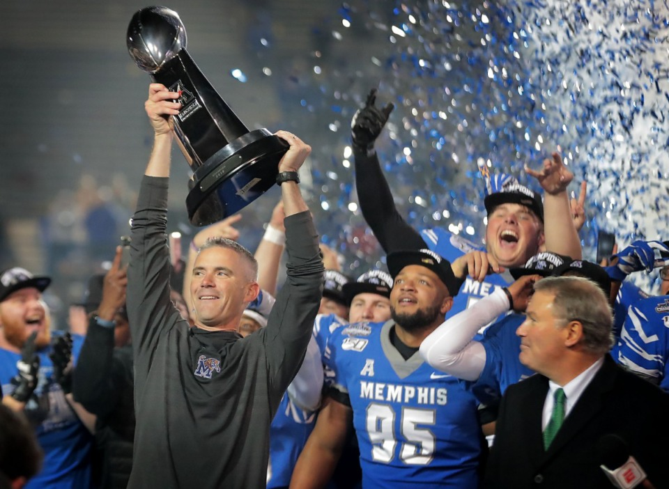 <strong>University of Memphis head coach Mike Norvell (left) celebrates with his team after the Tigers beat Cincinnati to win the AAC Championship game on Dec. 7, 2019, at Liberty Bowl Memorial Stadium.</strong> (Jim Weber/Daily Memphian)