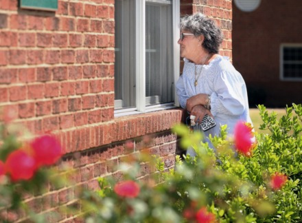 <strong>Memphis area nursing homes have had no-visiting rules in effect since March. Before greeting her husband Richard through a glass window at Ave Maria Home in Bartlett, Angela Capocaccia prayed outside the facility with a group called The Wings of Ave Maria Home. They prayed for the end of COVID-19.&nbsp;</strong>(Karen Pulfer Focht/ Special to the Daily Memphian)