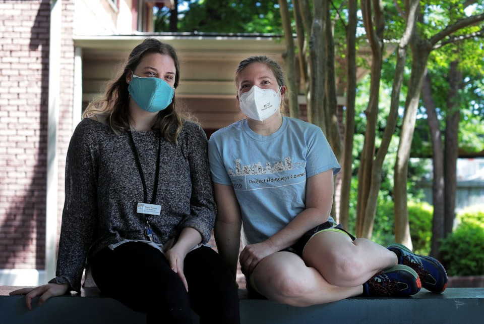 <strong>Hope House social workers Natalie Pritchard (left) and Sarah Dill sit on the porch of the Midtown non-profit May 14, 2020. Pritchard and Dill spent the day preparing food pantry boxes for needy Memphians.</strong> (Patrick Lantrip/Daily Memphian)