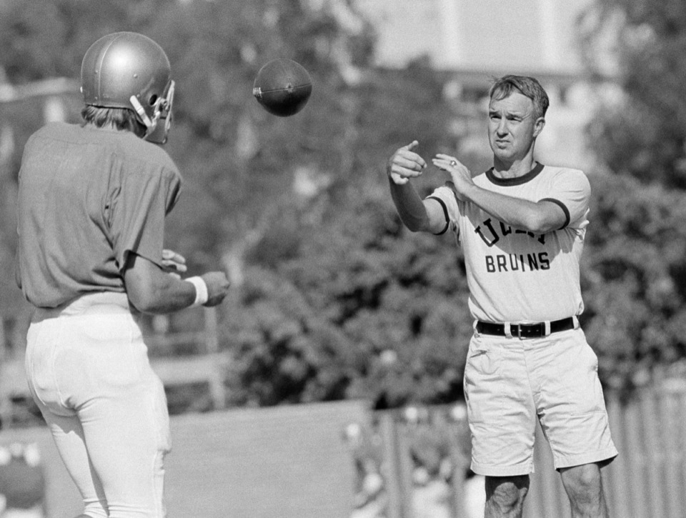 <strong>Coach Pepper Rodgers, right, works out with UCLA quarterback Mark Harmon on Sept. 13, 1972, in Los Angeles.</strong>&nbsp;<strong>Rodgers died May 14, 2020.</strong> (AP file)
