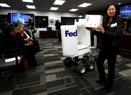 <strong>Rebecca Yeung, vice president of service experience leadership at FedEx Corp., shows the Memphis City Council how the company's new SameDay Bot will operate last year.&nbsp;FedEx and Microsoft have formed a new strategic alliance using their respective technologies to give businesses more visibility and control of inventories and supply chains.</strong> (Daily Memphian file)
