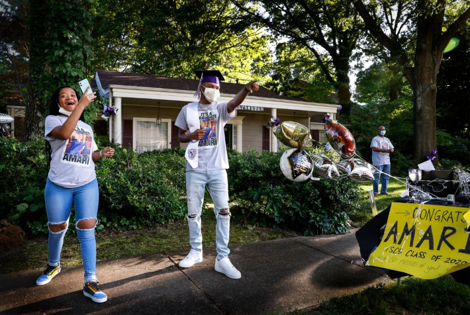 <strong>Amari Ajamu (middle), along with sister Nzinga Ajamu (left), celebrates his Stax Music Academy graduation with a car parade from family and friends on Monday, May 18, 2020. Ajamu, a miracle baby born three months premature 18 years ago, will become a fourth-generation student at Grambling in the fall.</strong> (Mark Weber/Daily Memphian)