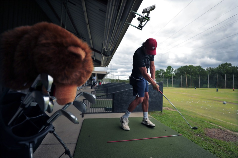 <strong>Derrick Baber works on his swing at Golf and Games Family Park, which reopened to the public May 19, 2020.</strong> (Patrick Lantrip/Daily Memphian)