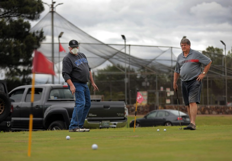 <strong>Tom Prestigiacomo reacts to Al Quarin's putt during a closest-to-the-hole game the pair played at Golf and Games Family Park May 19, 2020.</strong> (Patrick Lantrip/Daily Memphian)