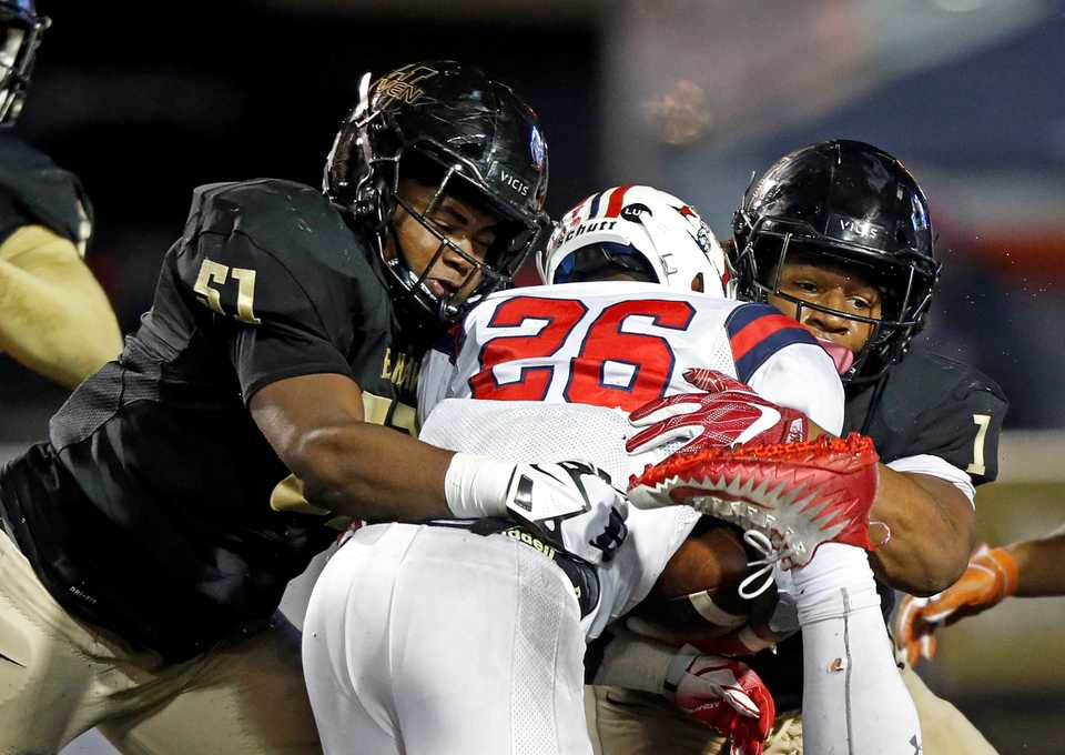 <strong>Whitehaven's Jarred Bradley (51) and Bryson Eason (1) tackle Oakland's Xavier Myers (26) during their championship game, Thursday, Nov. 29, 2018, in Cookeville, Tenn.</strong> (Wade Payne/Special to The Daily Memphian)