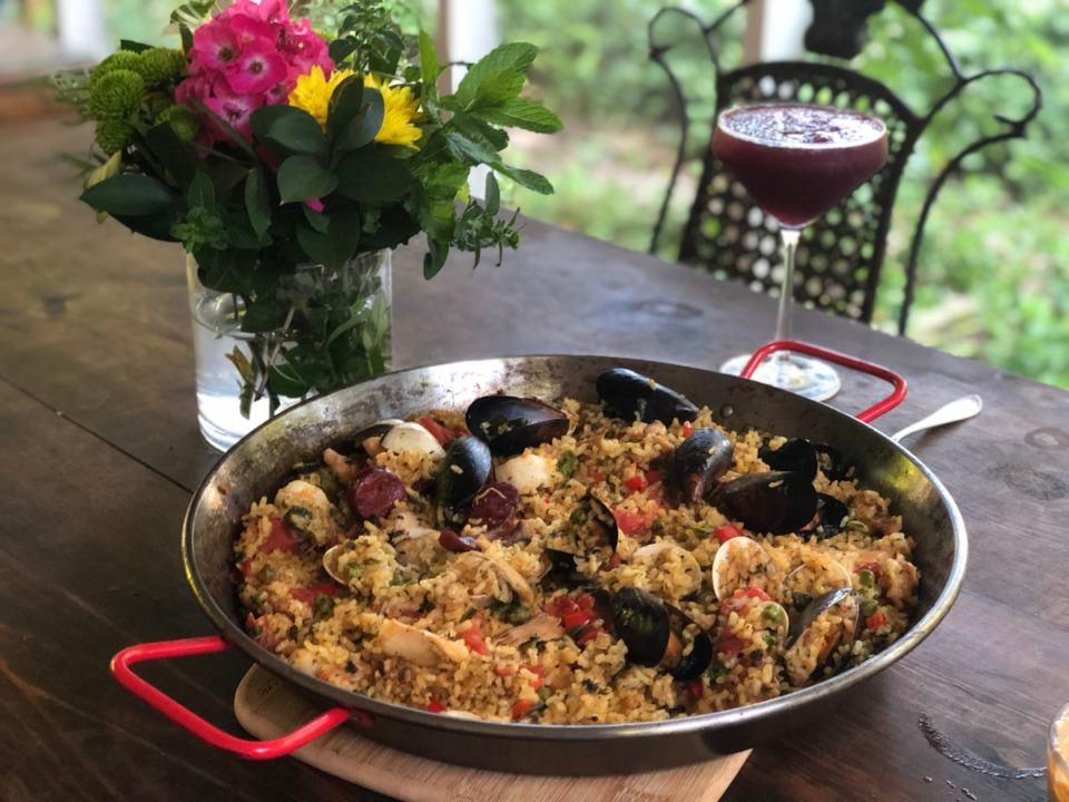 <strong>A generous paella from Sweet Grass is ready to enjoy with a sangria slushie.</strong> (Jennifer Biggs/Daily Memphian)