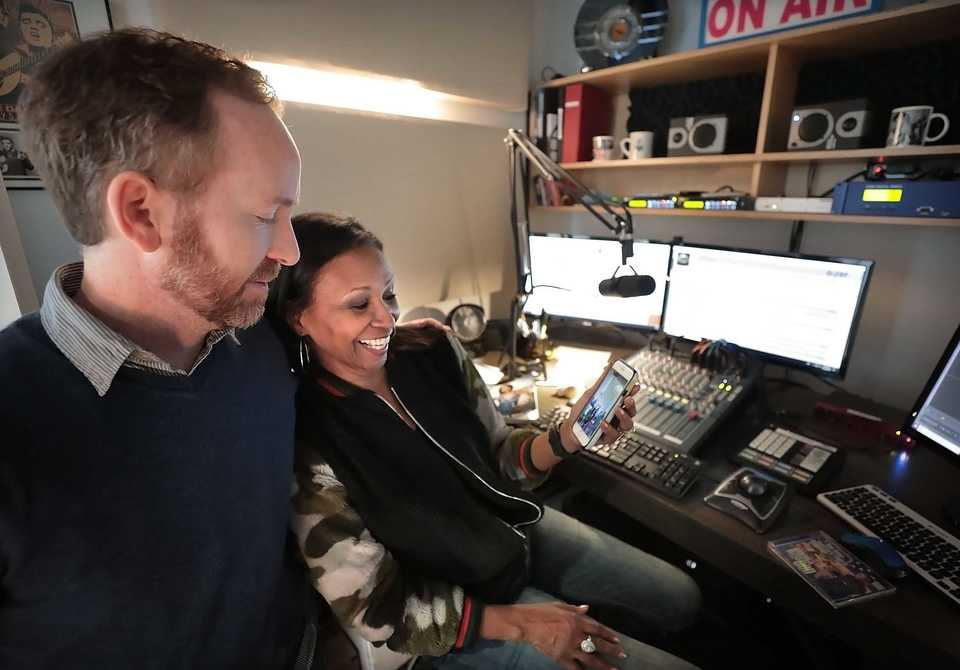 "<strong>Sheila Whalum (right), who hosts a radio show on WVZM called ""LOVETalk,&rdquo; shares a memory with Issac Harper, who also works at the Visible Music College's small radio station.</strong> (Jim Weber/Daily Memphian)"