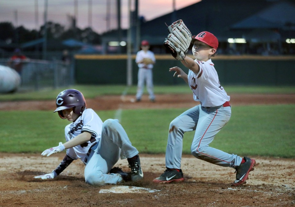 <strong>A Collierville Dragons player slides safely into home during a youth baseball tournament game against the Arlington Arsenal May 22, 2020.</strong> (Patrick Lantrip/Daily Memphian)