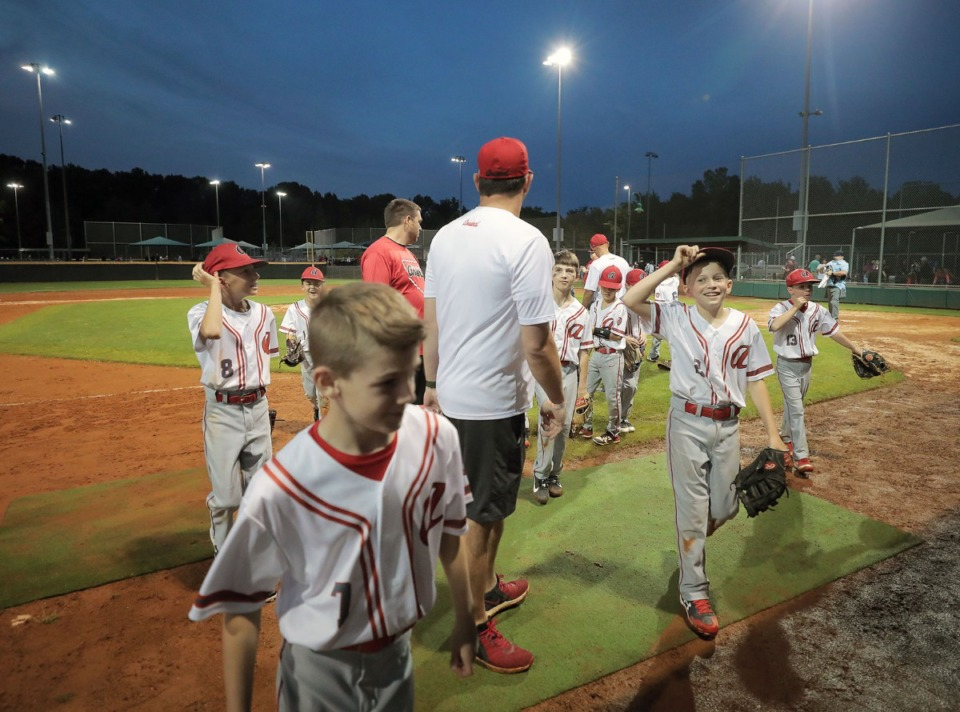 <strong>The Arlington Arsenal walk off the field after a youth baseball tournament game against the Collierville Dragons May 22, 2020.</strong> (Patrick Lantrip/Daily Memphian)