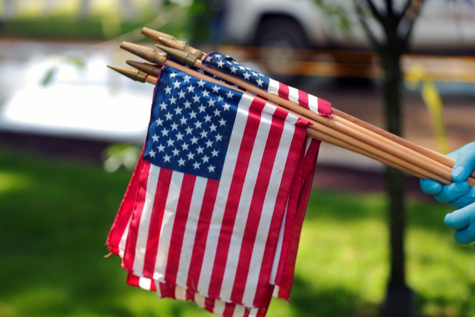 <strong>In preparation for the influx of visitors, many of the 153-year-old cemetery's mostly veteran staff spent May 22, 2020 planting small American flags and getting the gravesites ready for Memorial Day.</strong> (Patrick Lantrip/Daily Memphian)