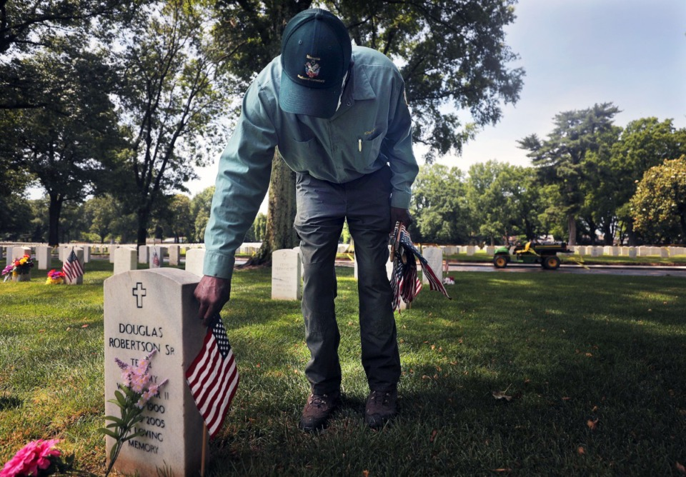 <strong>Air Force veteran Jesse Rowand walks the ground of the Memphis National Cemetery near Jackson Avenue on May 22, 2020, planting flags in preparation for Memorial Day.</strong> (Patrick Lantrip/Daily Memphian)