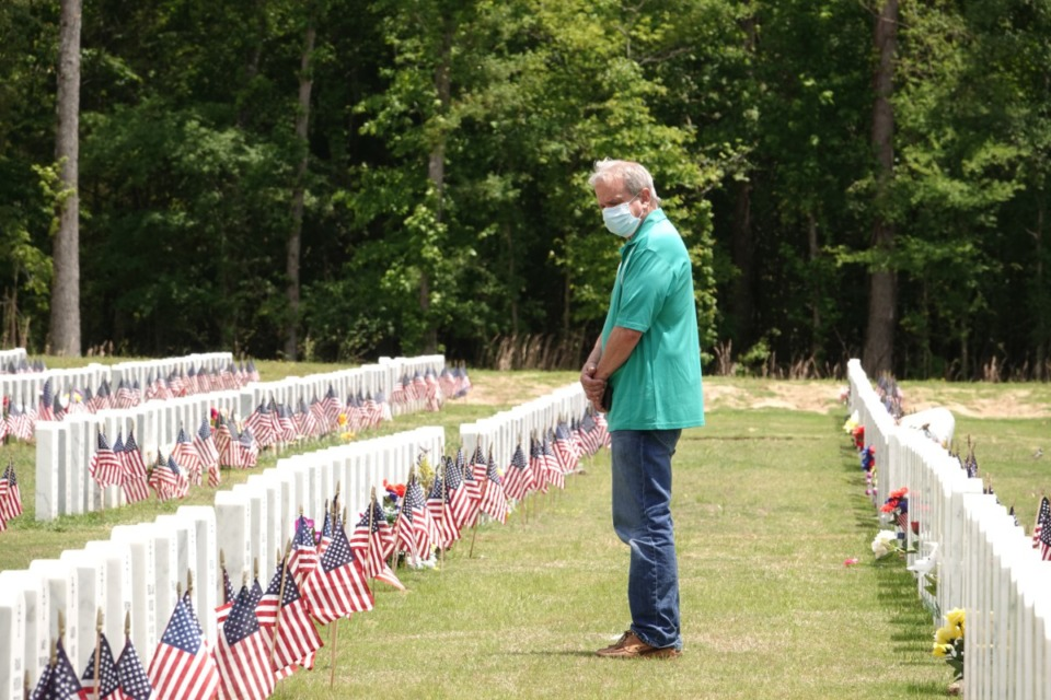 <strong>Shamus Donley visits the grave of his friend Gerald Ruden, Monday, May 18, 2020 at West Tennessee State Veterans Cemetery on Forest Hill-Irene Road. Mr. Ruden died in January at age 92, and Donley suspects undiagnosed COVID-19 is what killed his best friend.</strong> (Karen Pulfer Focht/ Special to the Daily Memphian)