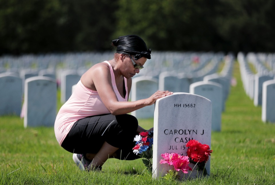 <strong>Marian Nelson pays her respects to her parents James and Carolyn Cash who are buried in the West Tennessee State Veterans Cemetery on Memorial Day</strong>&nbsp;<strong>May 25, 2020</strong>. (Patrick Lantrip/Daily Memphian)