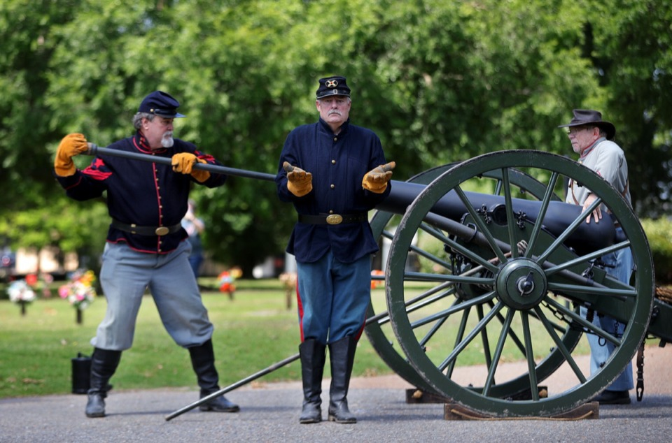 <strong>Members of Bankhead's Battery load a cannon (minus the artillery) to fire a salute to America's fallen troops during a Memorial Day ceremony at Memorial Park Cemetery May 25, 2020</strong>. (Patrick Lantrip/Daily Memphian)