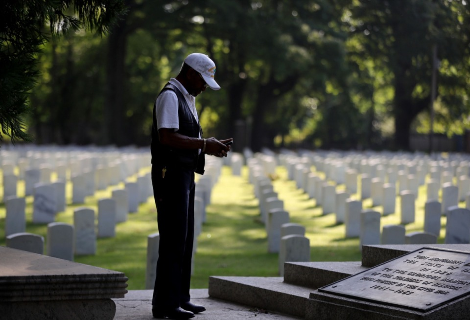 <strong>Korean War Navy veteran J.C. Benson takes a photo of a Civil War monument at the Memphis National Cemetery on Memorial Day May 25, 2020.</strong> (Patrick Lantrip/Daily Memphian)