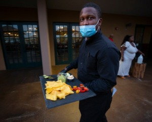 <strong>Server Karl Tate delivers food at Mississippi Terrace at Bass Pro on May 23, 2020.</strong> (Ziggy Mack/Special to Daily Memphian)