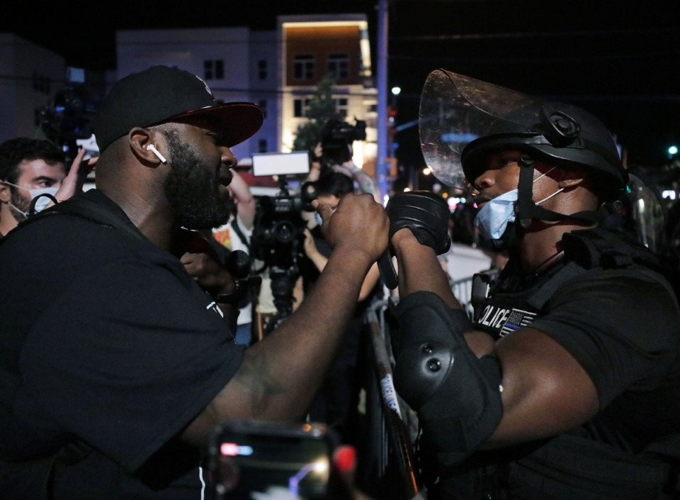 <strong>A Memphis Police officer fist bumps a protestor in an attempt to bring the May 28, 2020 protest over the death of George Floyd to a peaceful conclusion.</strong> (Patrick Lantrip/Daily Memphian)