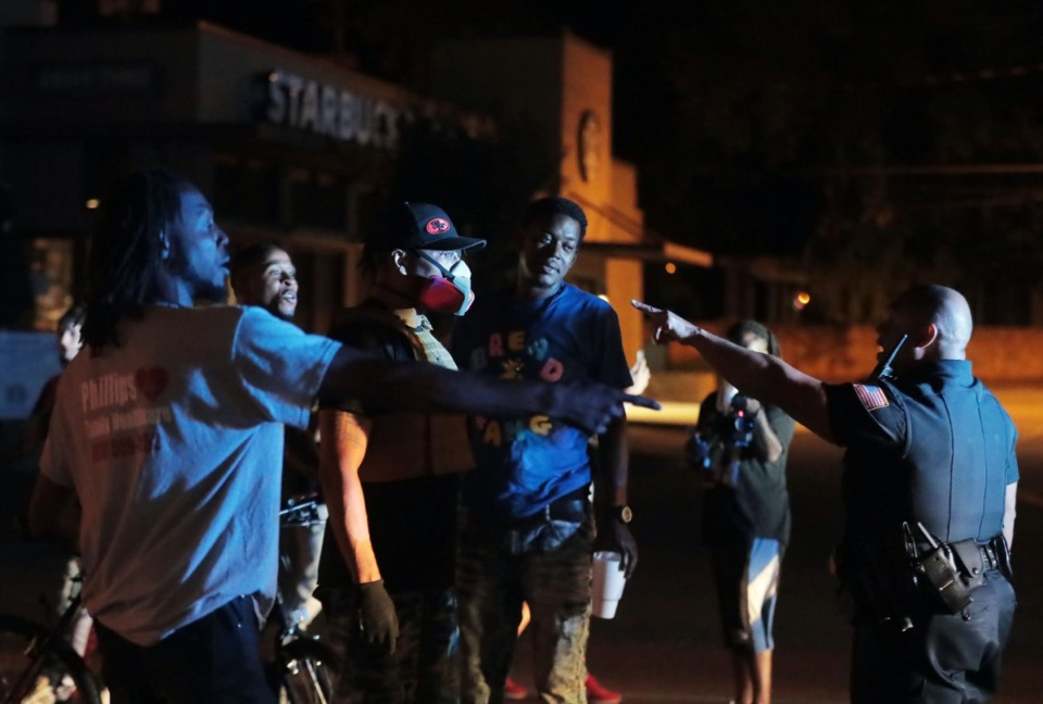 <strong>Despite the mostly peaceful evening, tensions began to run high as the protest wore one, as a man in a gas mask confronts police on Union Avenue during a May 28, 2020 protest over the death of George Floyd.</strong> (Patrick Lantrip/Daily Memphian)