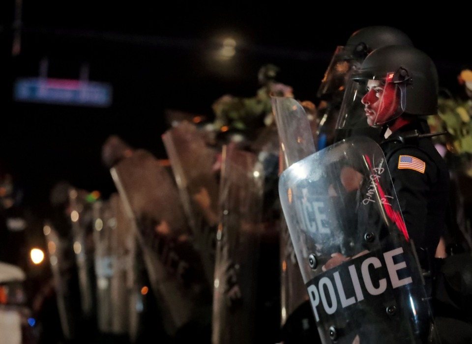 <strong>A Memphis Police officer looks out into the crowd during a May 28, 2020 protest over the death of George Floyd.</strong> (Patrick Lantrip/Daily Memphian)