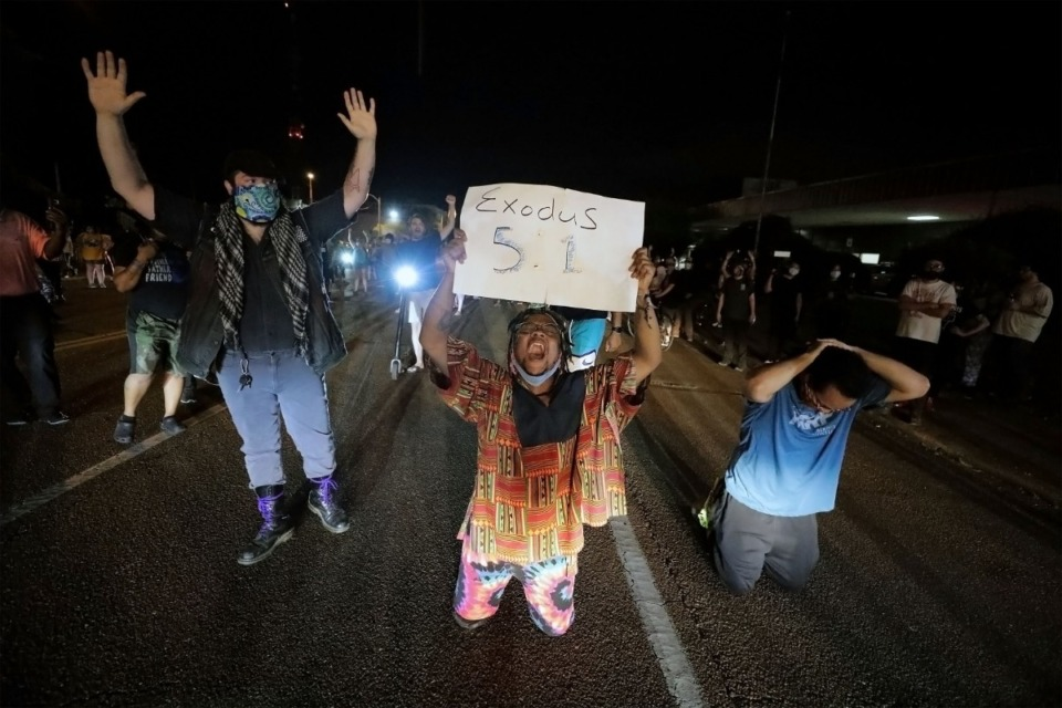 <strong>Protesters kneel in front of the Union Avenue police station in Memphis, Tennessee during a May 28, 2020 protest over the death of George Floyd.</strong> (Patrick Lantrip/Daily Memphian)