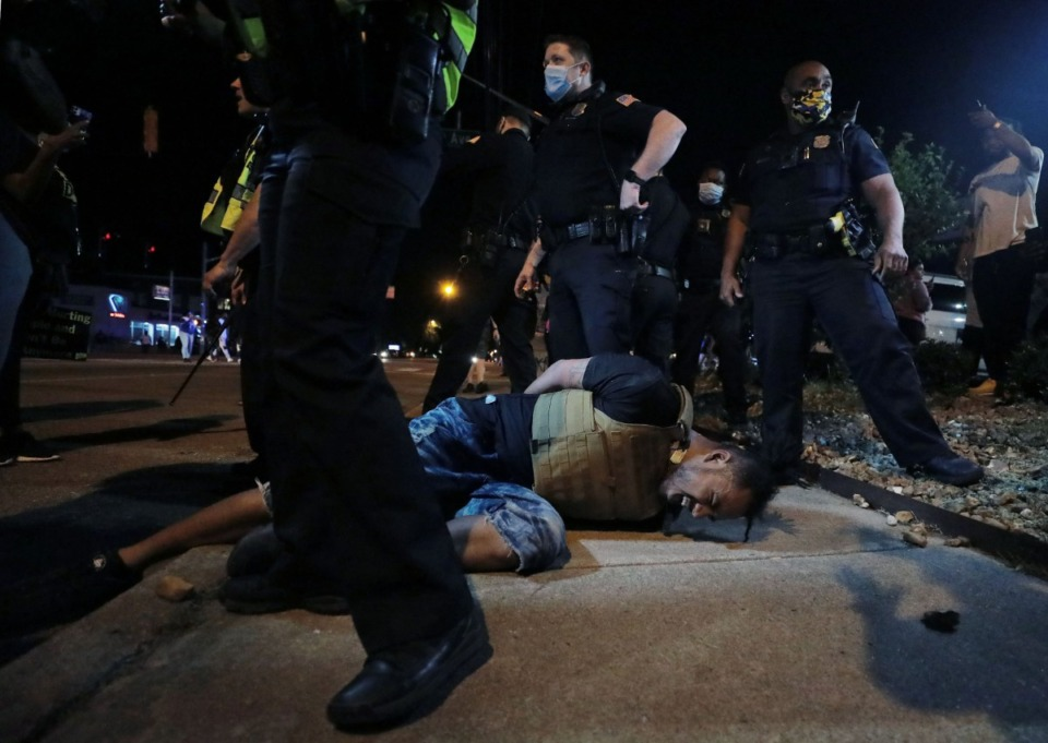 <strong>A protestor winces in pain after being pepper sprayed by Memphis police during a May 28, 2020 protest over the death of George Floyd.</strong> (Patrick Lantrip/Daily Memphian)